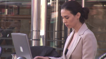 business woman working on laptop in a cafe