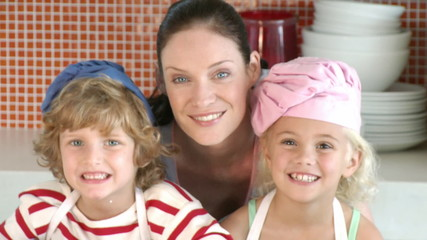 caring mother baking with her children