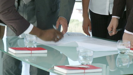 close-up of businesspeople hands during meeting