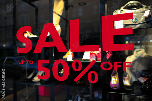 Sale (up to 50% off) sign in a fashion shop window