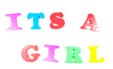 its a girl, written in fridge magnets