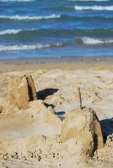 Sand castle on the beach against the sea, Rimini, Italy