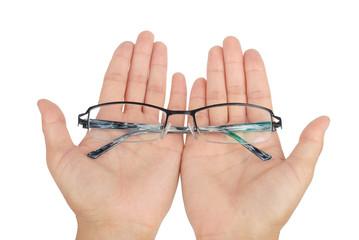 eyeglasses on hand