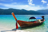 Traditional Thai longtail boat at the beach, Rawi island, Thaila