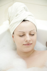 young adult women having spa in bathroom and relax