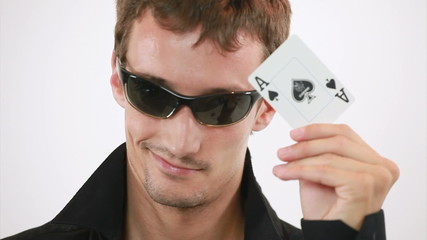 Guy is turning the card - its ace