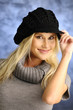 Blond girl in a black hat