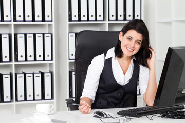 happy businesswoman in office