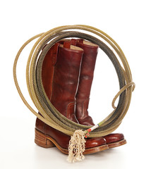 Western theme photo Cowboy boots and lasso