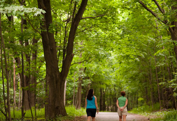 Two women walking in a wooded park