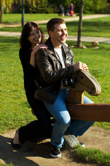 young couple in a baby swing