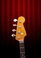 Bass Guitar Head on Dark Red Background