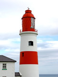 A Traditional British Red and White Lighthouse. poster