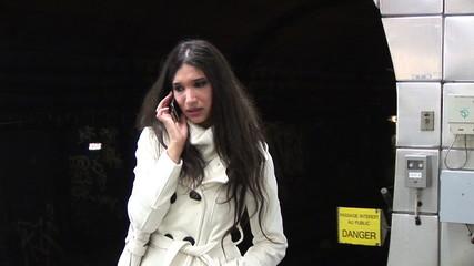 woman speaking on phone in the metro
