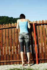 Woman looking over the fence
