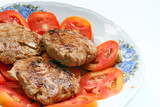 Pork and onion HamBurger with Red slced Tomato