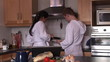 young attractive couple making breakfast