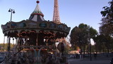 A carousel in front of the Eiffel tower