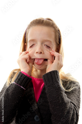 Girl is making funny face over white background