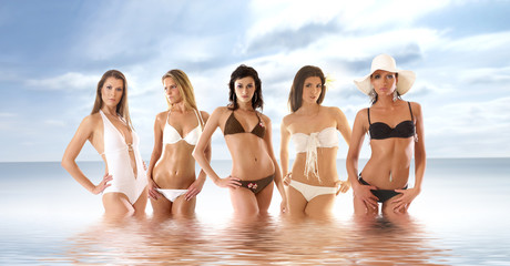Five young and sexy girls stainding in the sea