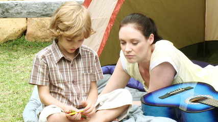 loving mother with son during camping