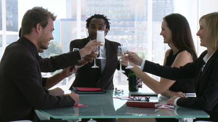 young businessteam celebrating big contract with champagne