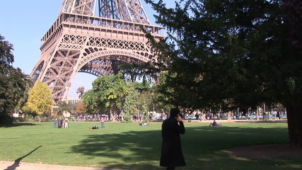 Man talking on phone at the Eiffel Tower in Paris