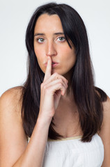 Woman making shushing motion with finger on lips