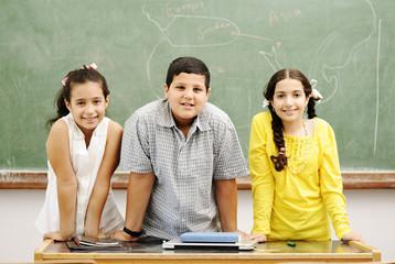 Three children in classroom