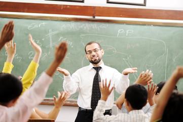 Interaction between teacher and children, funny class in school