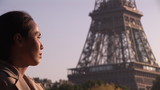 woman relaxing with Eiffel tower on the background