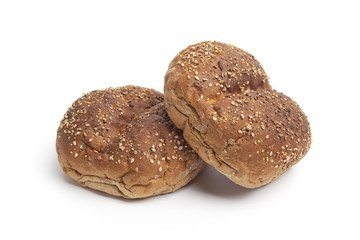 Fresh multi-grain rolls on white background