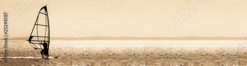 sepia toned windsurfer panorama