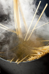 Spaghetti being cooked in hot water.