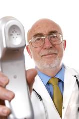 Senior doctor holding telephone