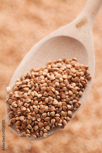 buckwheat in wooden spoon