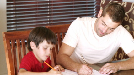 father drawing with his son