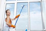 Nice girl washing a window