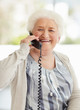 Happy mature woman talking over telephone