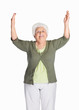 Happy mature woman with hands raised isolated against white