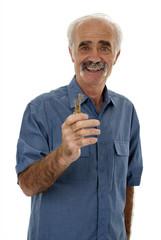 Senior man holding door key
