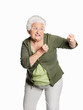 Mature woman in fighting gesture isolated against white