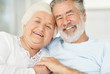 Closeup of a smiling senior couple holding each others hand