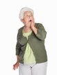 Shocked elderly female isolated against white background