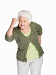 Senior woman in angry gesture isolated against white