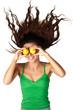 Beautiful woman hold lemons near eyes hair dishevelled isolated