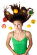 Beautiful woman lying with fruits hair is dishevelled isolated