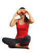 beautiful woman sitting and hold apples near eyes isolated
