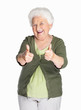 Happy mature woman showing thumbs up isolated against white