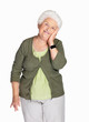 Happy elderly female with hand on chin against white background